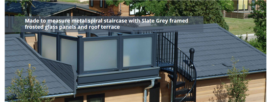 Made to measure metal spiral staircase with Slate Grey framed frosted glass panels and roof terrace