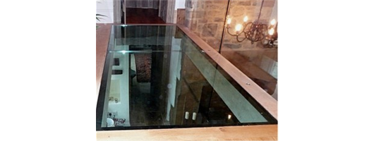 Laminated glass floor with Oak trims and Structural Glass balustrade