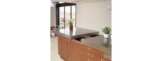 Large stainless steel island worktop with special sliding section to reveal additional storage
