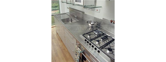 Stainless steel sinktop with drainer recess, integral back upstand, lipped front and side edges