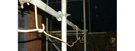 Skyhooks hanging from scaffolding