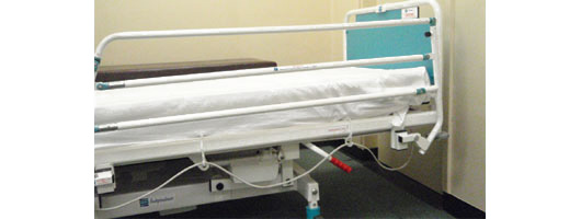 Medihook supporting cables on hospital bed