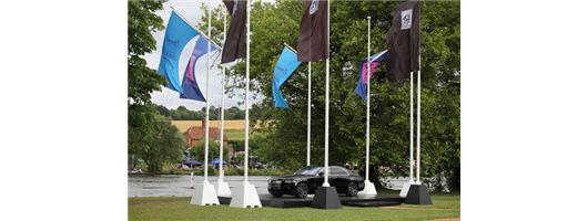 21-Combination of 9mt flagpoles with and without gaff arms on concrete blocks to fly both portrait style and angled flags – hired at Fawley Court 2016 for The Henley Regatta