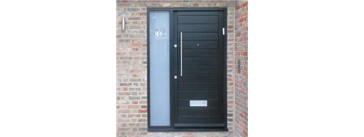 Bespoke black front door set with a sidelight