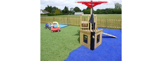 Artifiical grass playground safety surfacing with pirate ship