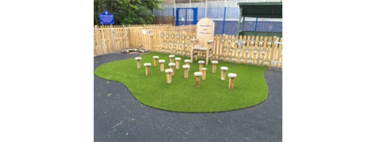 Artificial grass in playground around a story telling chair