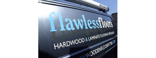 Basic blue and white vinyl text on signwritten vehicle